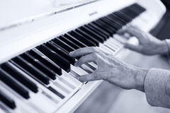 Piano with multy coloure keys. Close up Royalty Free Stock Photo