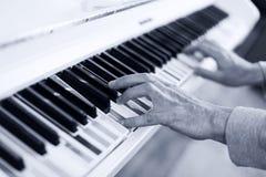 Piano with multy coloure keys. Close up. Lerning to Play white piano with multy coloure keys Royalty Free Stock Photo