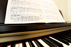 Piano and music paper Stock Images