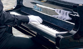 Piano music pianist hands in white signets playing royalty free stock photos