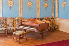 Piano in music saloon in palace Saint Anton Royalty Free Stock Photo