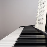 Piano with music sheet. Piano keys and music sheet stock images