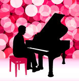 Piano Musician on Lens Flare Background Stock Images
