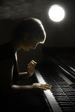 Piano musician pianist. Pianist musician piano music playing. Musical instrumant grand piano with beautiful woman performer Stock Photography
