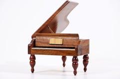 Piano no branco foto de stock royalty free