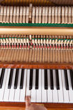 Piano. Note playing on an old opened upright piano Stock Photo