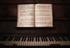 Piano & Notes. Old piano with note sheet Stock Images