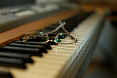 Piano with notes and glasses. Music Creativity. Glasses on focus on piano stock photo
