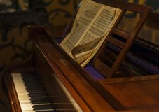 Piano and Notes. Vintage piano with the notes. Sounds and music royalty free stock photography