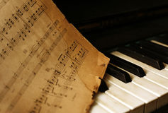Piano and old notes Stock Photography