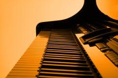 Piano in orange. Piano with orange backlight Stock Photos