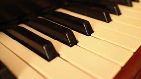 PIANO-ORGAN KEYS (Dolly Move) - Faster diagonal dolly down keys stock video footage