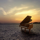Piano outside shot at sea side Stock Photos