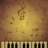 Piano on paper background with music notes Royalty Free Stock Photos