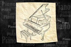 Piano Paper Drawing on blackboard. Music background Royalty Free Stock Images