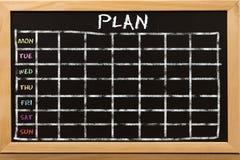 Piano per la settimana sulla lavagna Immagini Stock