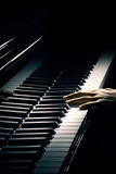 Piano pianist playing. Piano music pianist hand playing. Musical instrument grand piano details with performer hands on black background Royalty Free Stock Photo