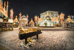 Piano without pianist. Decorative piano in front of Christmas decorations at the Bolshoi Theatre Royalty Free Stock Photos