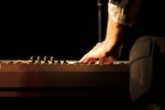 Piano Player. Playing the synthesizer during a concert stock photos