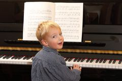 Piano Player. Portrait of a young boy playing piano Royalty Free Stock Photo