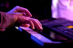 Piano Player. Close up of hands playing a piano during a live performance Royalty Free Stock Photo
