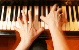 Piano player. Flying fingers Stock Photos
