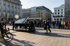 Piano player. The Piano accross the world in Hamburg Stock Photography