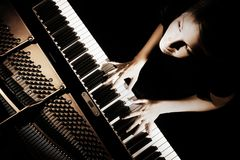 Piano player. Pianist playing grand piano concert Royalty Free Stock Image