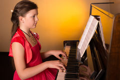 Piano player. Piano player. Girl Playing Piano. Royalty Free Stock Photo