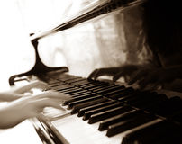 Piano with players hands Royalty Free Stock Photos