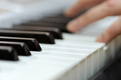 Piano with players hands Royalty Free Stock Photography