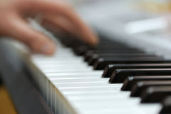Piano with players hands Stock Photos