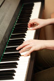 Piano playing Stock Image
