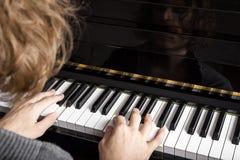 Piano playing Stock Photo