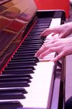 Piano playing. Hands playing the piano Royalty Free Stock Photos