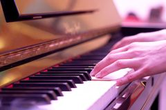 Piano playing. Hands playing the piano Royalty Free Stock Image