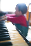 Piano playing baby Royalty Free Stock Images
