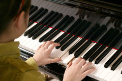Piano Playing Child Stock Photo
