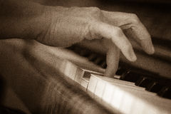 Piano playing. Detail of wooden piano bw Royalty Free Stock Image