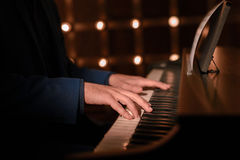 Piano. Playing. The sound of the melody. The guy playing the Royalty Free Stock Photography