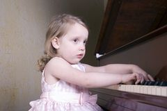 Piano practice. Preschooler playing the piano Royalty Free Stock Photos