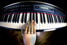 Piano Practice by Wooden Hand.. Royalty Free Stock Photos