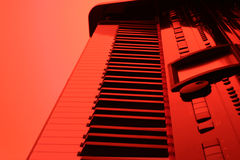 Piano in red. Piano with red backlight royalty free stock photo