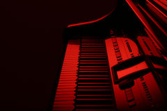 Piano in red. Piano with red backlight Stock Photo