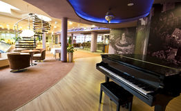 Piano in restaurant. Interior of a modern hotel, the restaurant with a classic piano in the foreground Stock Photography