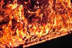 Piano rojo en llama anaranjada Imagenes de archivo