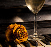 Piano with rose on the keys and wine Royalty Free Stock Image