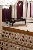 Piano on scene and empty chairs in the concert hall royalty free stock photos