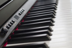 Piano. Selective focus piano keyboard with the light Royalty Free Stock Photography