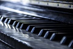 Piano, selective focus, nostalgic effects, neutral colour. Piano with selective focus on black keys, nostalgic effects and neutral colour, 27 June 2018 stock images